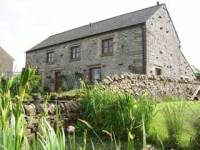 Derbyshire Self Catering Bailey Flatt Barn, Buxton. Stone barn conversion with hot tub and pond.
