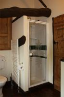 Family bathroom with bath, shower, toilet, sink and airing cupboard facilities.