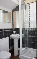 En-suire shower room with shower, toilet and sink facilities.