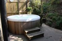Outdoor hot tub and barbecue area.